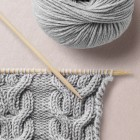 Doppelter Nullenzopf, WOOL SCHOOL, HAPPY KNITTING