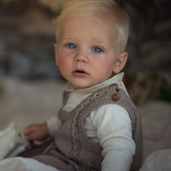Knit romper GLEN handknitted of virgin merino wool VAN BEREN