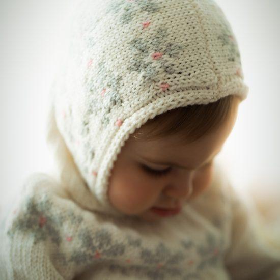Knit bonnet BROOKS handknitted of virgin merino wool VAN BEREN