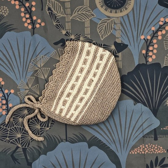 Knit bonnet ESTHER handknitted of virgin merino wool VAN BEREN