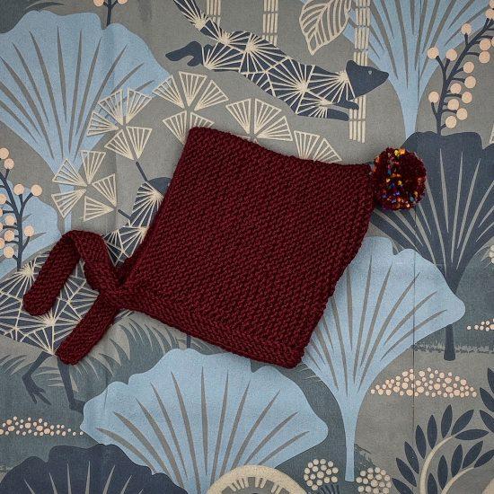 Knit bonnet BILLIE handknitted of virgin merino wool VAN BEREN