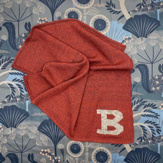 Baby blanket LETTER COLLECTION handknitted of merino wool VAN BEREN