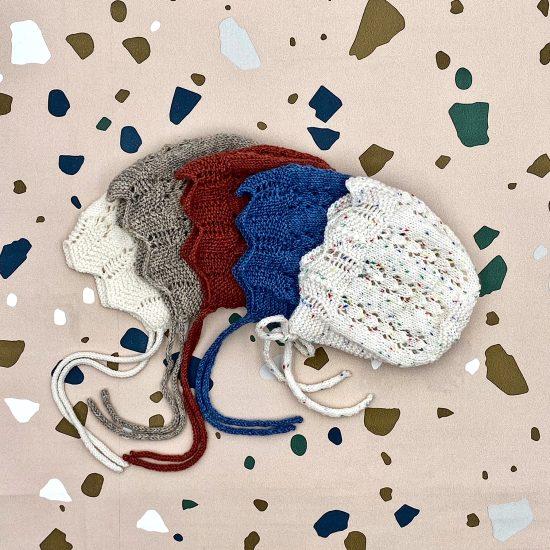 Baby bonnet STELLA handknitted of merino wool VAN BEREN